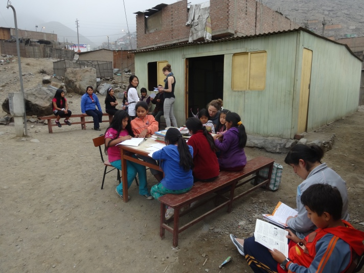 Nutrition Workshop needed the classroom and the Biblioteca students were more than happy to take the opportunity to read outside. Women wait (top left) for their individual assessments.