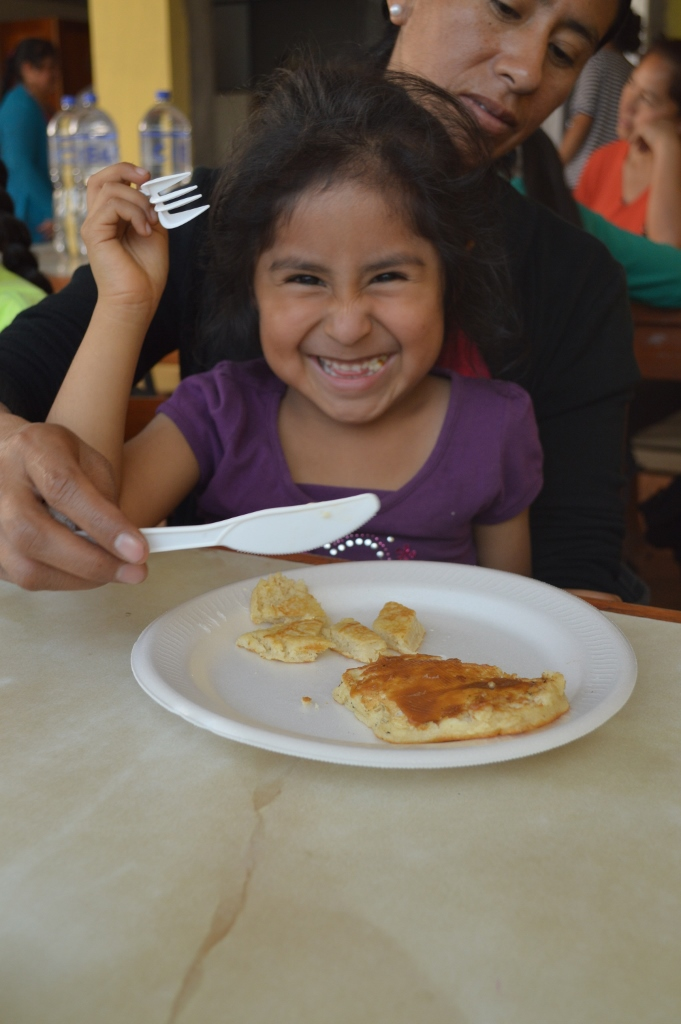 Brenda, little sister to LLI student Mariel, is lovin' her pancakes!
