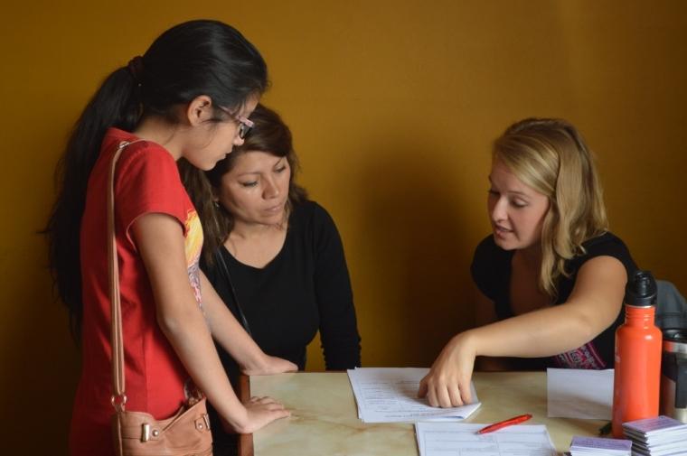 Shelby, LLI's women's program manager, registering a new women's participant.